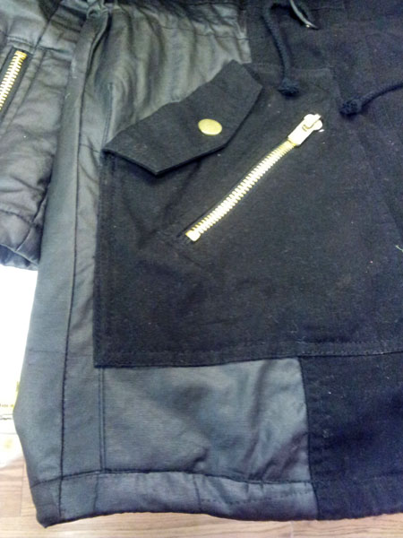coat torn and repaired using material from coat